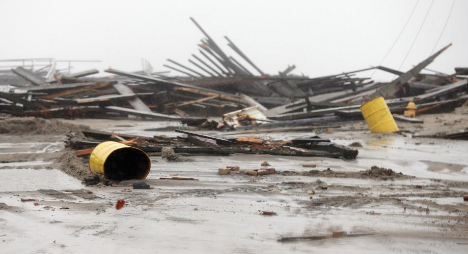 Debris from flooding is scattered on a street near the ocean as Hurricane Sandy moves up the coast on Monday in Atlantic City, New Jersey.