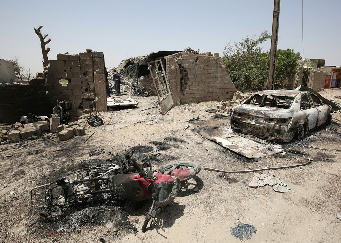 Picture taken on June 30, 2016 shows the remains of damaged vehicles in the city of Fallujah following battles between Iraqi pro-government forces and Islamic State group jihadists.