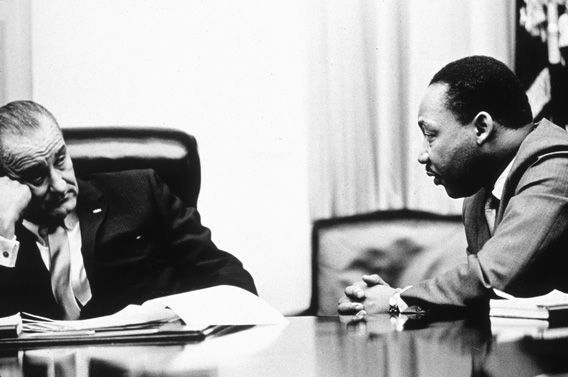 President Lyndon B Johnson (1908 - 1973) discusses the Voting Rights Act with civil rights campaigner Martin Luther King Jr. (1929 - 1968).