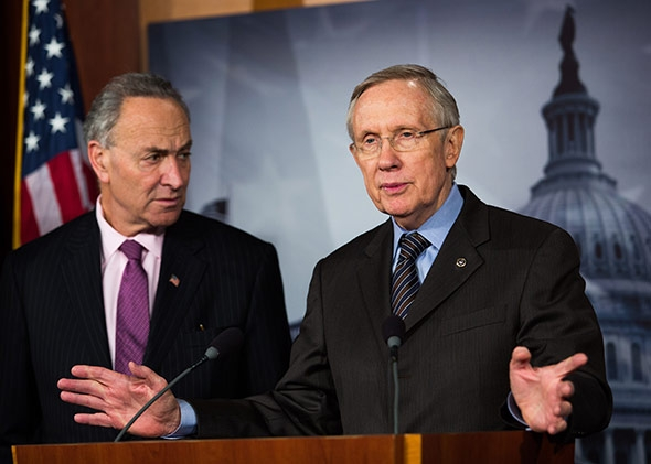 Sen. Chuck Schumer (D-NY) looks on while Senate Majority Leader Harry Reid (D-NV) speaks.