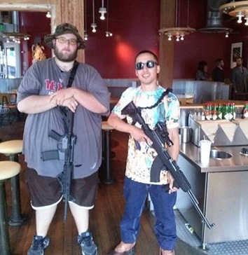Members of the gun rights group Open Carry Texas pose in a Chipotle restaurant.
