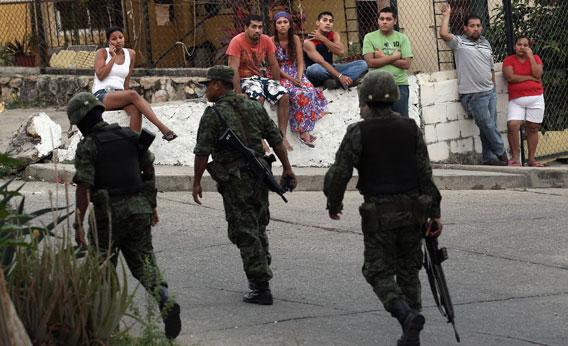 Mexican soldiers near at the site of a suspected drug execution on February 28, 2012 in Acapulco, Mexico.