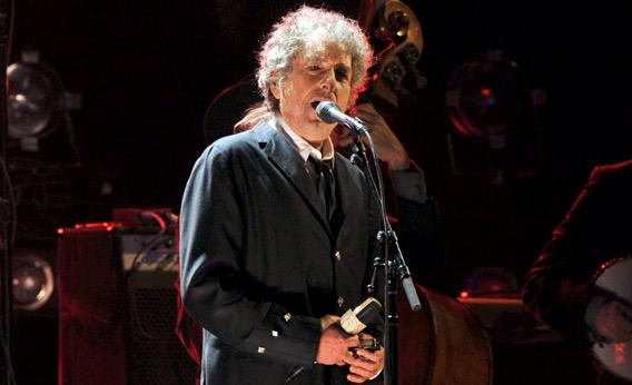 Bob Dylan performs onstage.