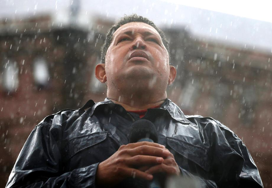 Chavez speaks in the rain during a campaign rally in Caracas, Oct. 4, 2012.