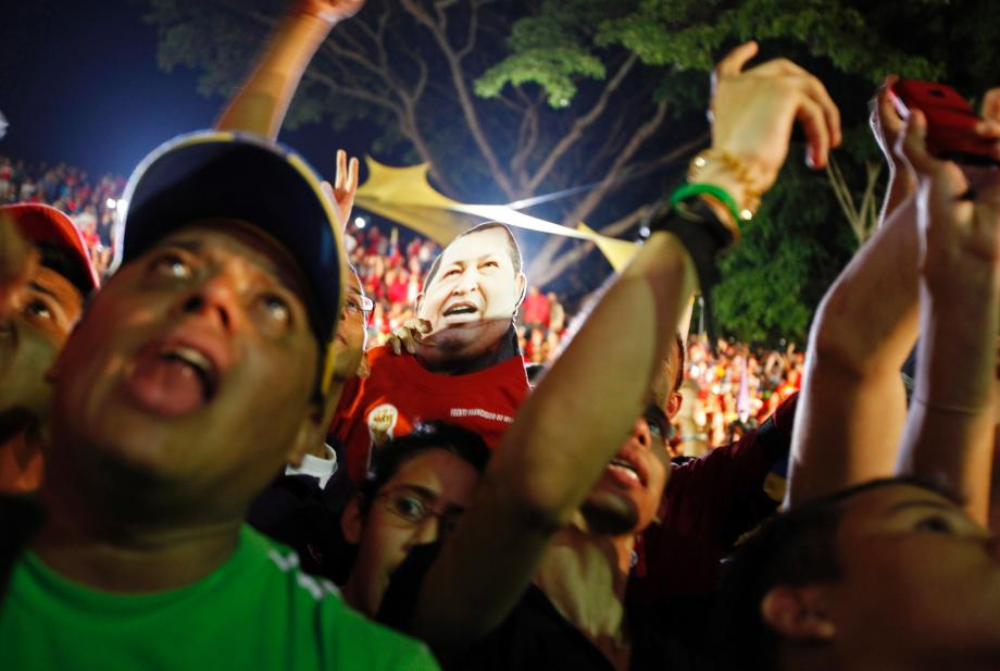 Supporters of Venezuelan President Hugo Chavez cheer as he appears on a balcony of Miraflores Palace in Caracas October 7, 2012. Venezuela's socialist President Chavez won re-election in Sunday's vote with 54 percent of the ballot to beat opposition challenger Henrique Capriles.