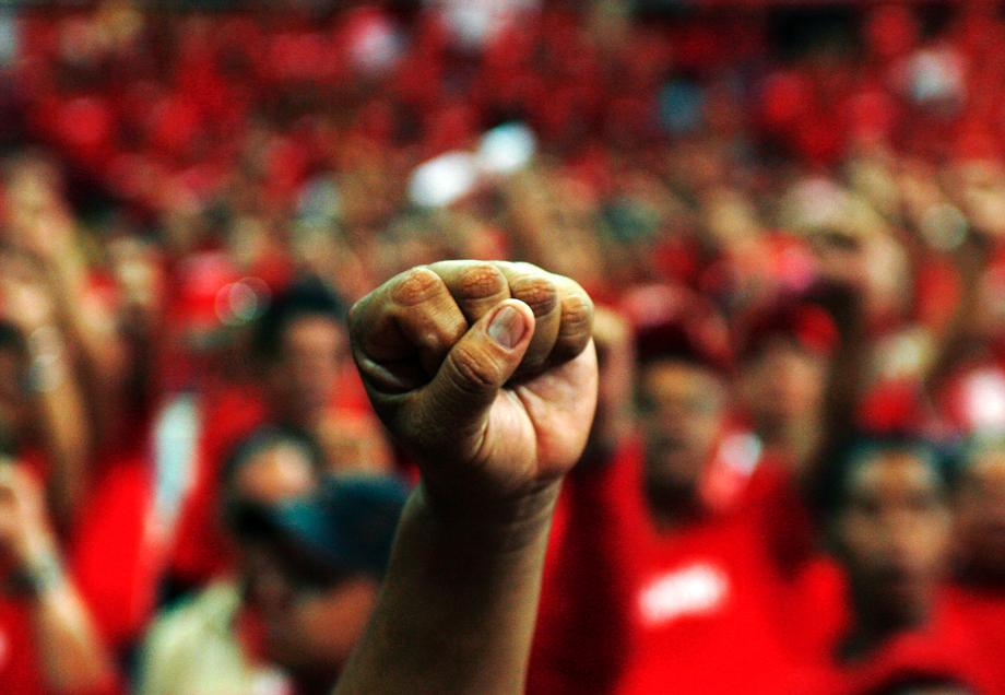 A supporter of Venezuelan President Hugo Chavez raises his left fist at a rally to promote Chavez's new United Venezuelan Socialist Party (PSUV) in Caracas April 19, 2007.
