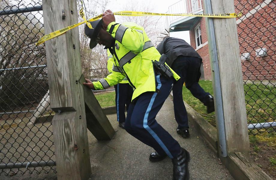 Police search for one remaining suspect at an apartment building where a resident reported finding drops of blood on April 19, 2013 in Watertown, Massachusetts. Earlier, a Massachusetts Institute of Technology campus police officer was shot and killed at the school's campus in Cambridge.