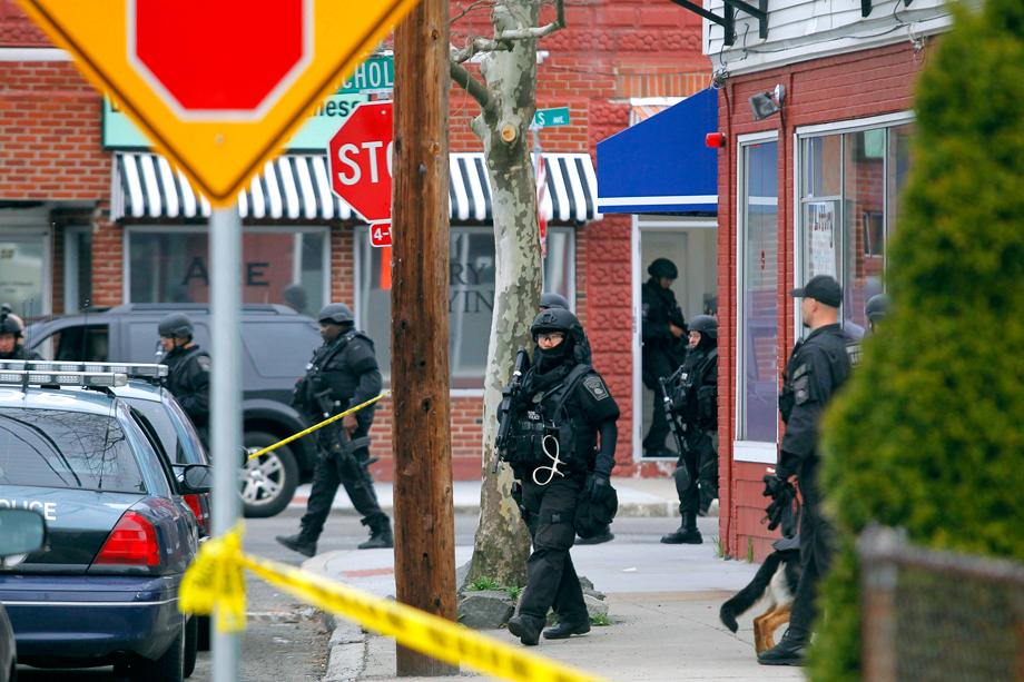 SWAT teams enter a suburban neighborhood to search for the remaining suspect in the Boston Marathon bombings in Watertown, Massachusetts April 19, 2013. Two Boston bomb suspects were named as brothers, Dzhokhar A. Tsarnaev, 19, and his brother Tamerlan Tsarnaev, 26, a U.S. national security official said on Friday. The official said the older brother died in a shootout with police and the younger one was being sought in a house-to-house search for in the Boston suburb of Watertown.