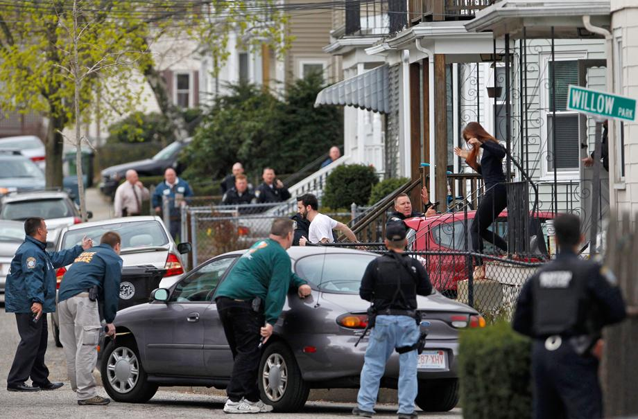 Police officers search homes for the Boston Marathon bombing suspects in Watertown, Massachusetts April 19, 2013.