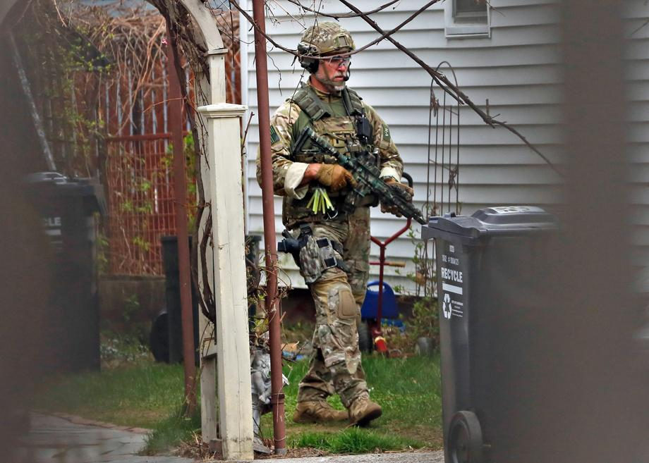 A FBI agent walks from a residence next to 412 Norfolk street in Cambridge, Massachusetts April 19, 2013. Police killed one suspect in the Boston Marathon bombing, Tamerlan Tsarneav, in a shootout and mounted house-to-house searches for the second man, his brother Dzhokar Tsarnaev, in the Boston suburb of Watertown, officials said on Friday, with much of the city under virtual lockdown after a bloody night of shooting and explosions in the streets.