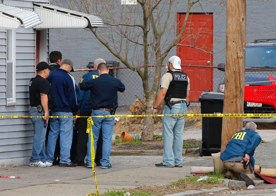 FBI agents search for the Boston Marathon bombing suspects in Watertown, Massachusetts April 19, 2013.
