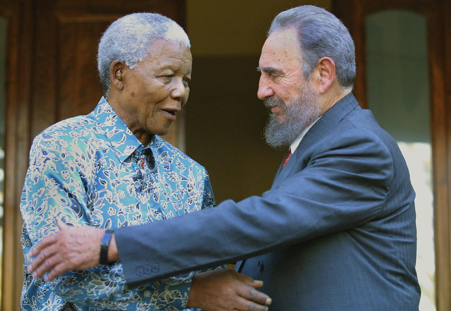 Former South African president Nelson Mandela hugs Cuban president Fidel Castro at Mandela's office in Johannesburg 02 September 2001. Castro who took part in the UN World Racism conference in Durban used the opportunity to visit Mandela, whose health is effected by cancer.