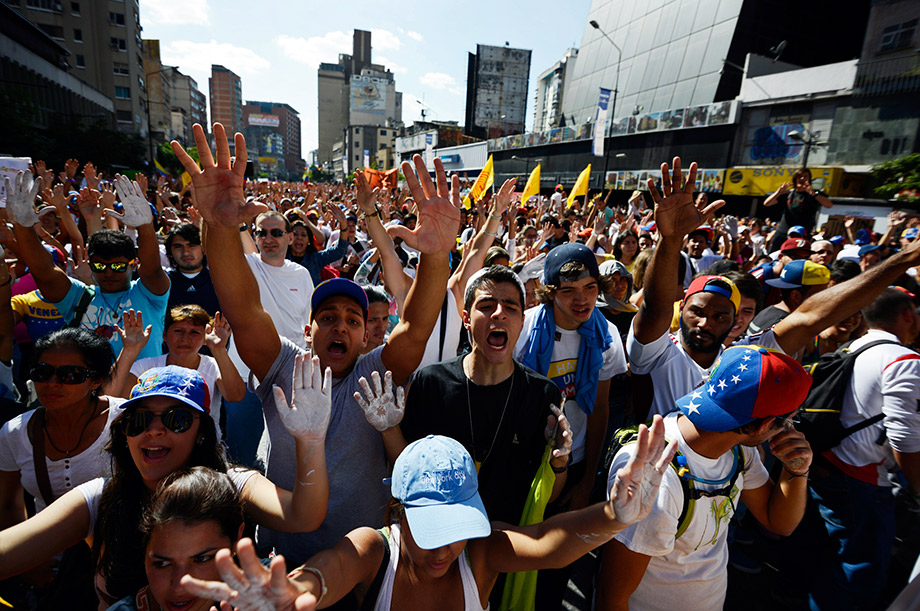 Anti-government students shout slogans during a protest in front of the Venezuelan Judiciary building in Caracas.