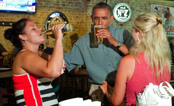 President Obama shares a beer with Suzanne Woods, right, and Jennifer Klanac.