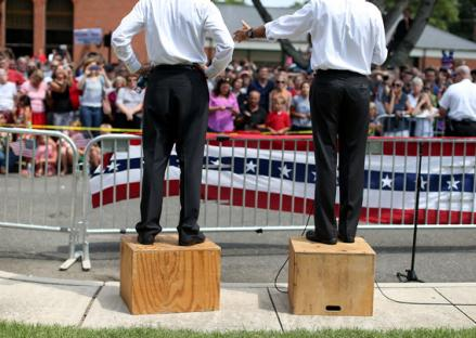 Mitt Romney, right, and Paul Ryan, left, speak to an overflow crowd during a campaign rally at Randolph Macon College in August in Ashland, Virginia.