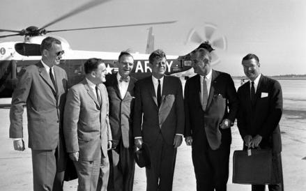 President John Kennedy poses with member of his party before air takeoff on Sept. 11, 1962.