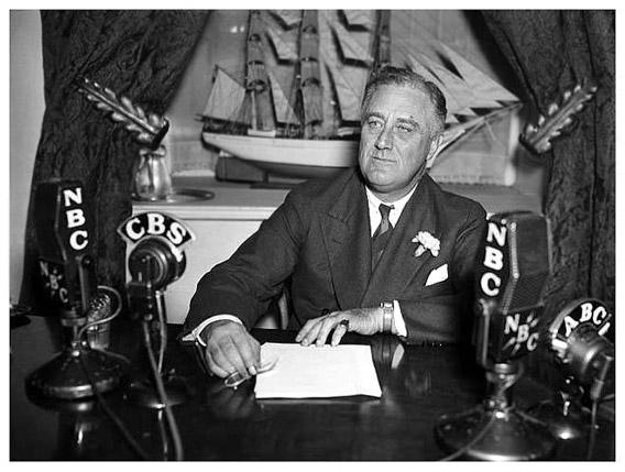 Franklin D. Roosevelt during one of his fireside chats, on August 1933.