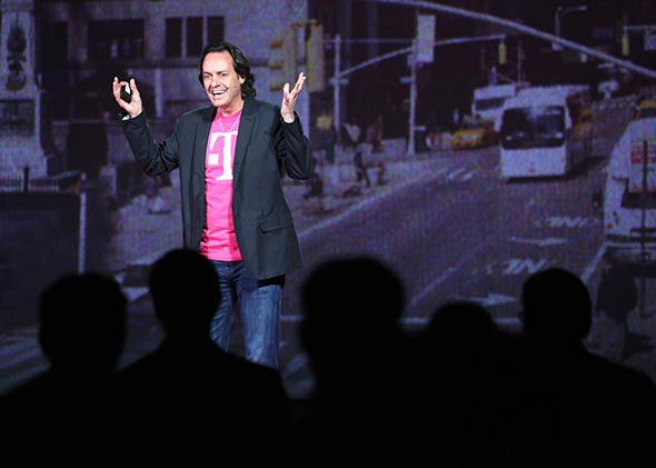 John Legere, CEO and President of T-Mobile USA, makes an announcement during an event about new contract pricing on March 26, 2013 in New York City.