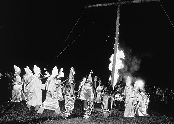 the origin and history of the ku klux klan The ku klux klan is the oldest  klan members have a history of bringing children to  a robed and masked ku klux klansman stands on a dirt road.