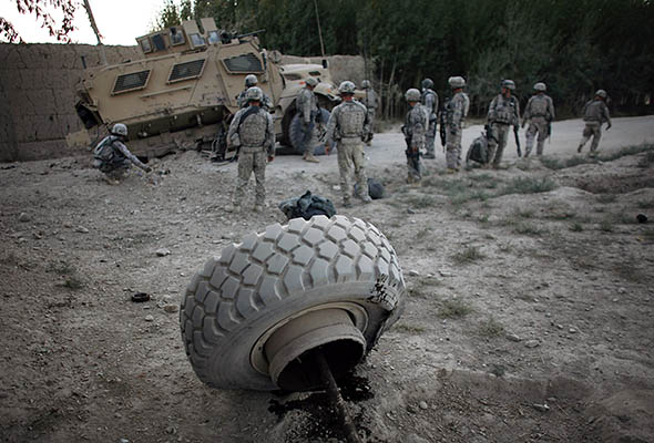 U.S. soldiers inspect damage to their armored vehicle after an near the village of Eber in Logar province, Afghanistan, on Sept. 26, 2009.