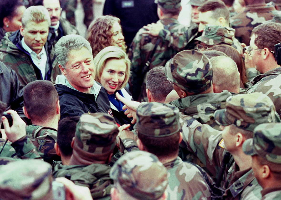President Bill Clinton and first lady Hillary Rodham Clinton meet with American soldiers on their arrival in Tuzla, Bosnia, on Dec. 22, 1997.