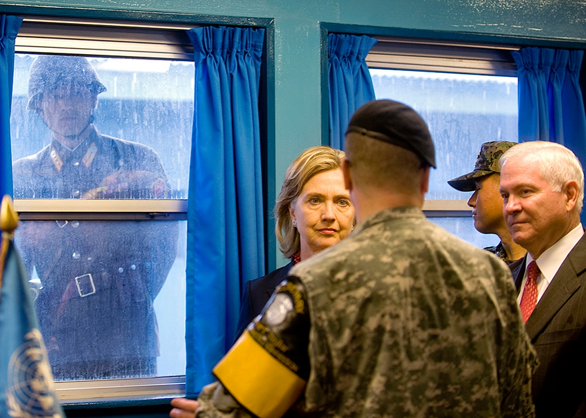 Secretary of State Hillary Clinton and Secretary of Defense Robert Gates visit the U.N. truce village building that sits on the border of the Demilitarized Zone on July 21, 2010, in Panmunjon, South Korea.