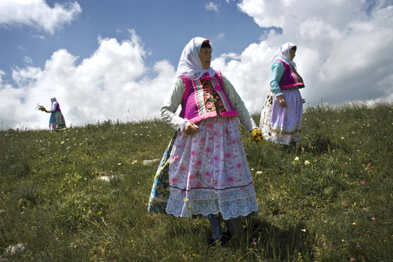 Doukhobor women in a grassy meadow in Gorelovka, Georgia.