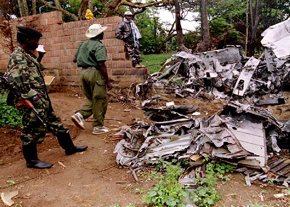 Rwanda Patriotic Front (R.P.F.) rebels inspect the wreckage of the plane in which Rwandan President Juvenal Habyarimana was killed, May 26, 1994.