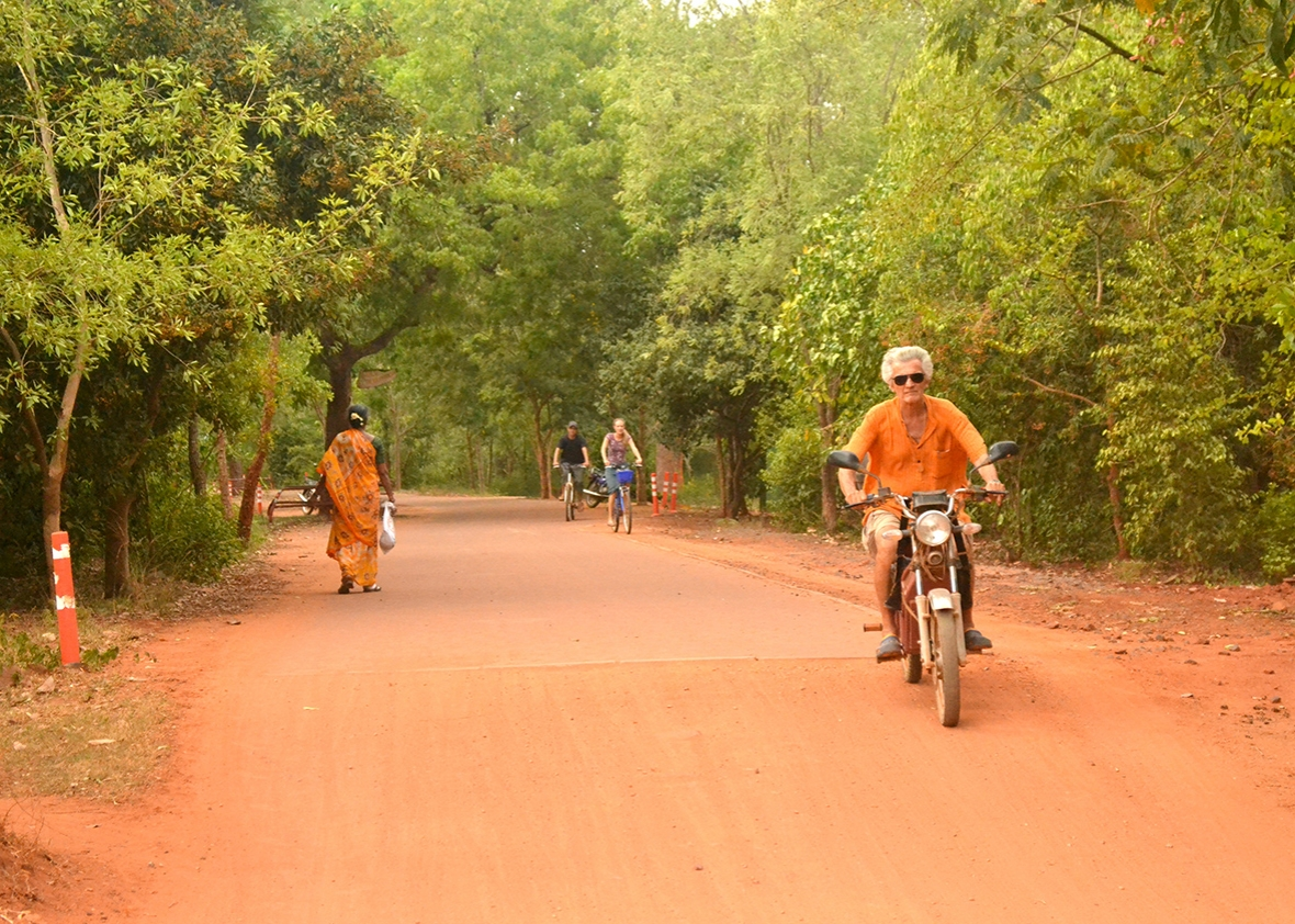 auroville s famed utopian community struggles crime a typical road in auroville which strongly discourages cars from entering
