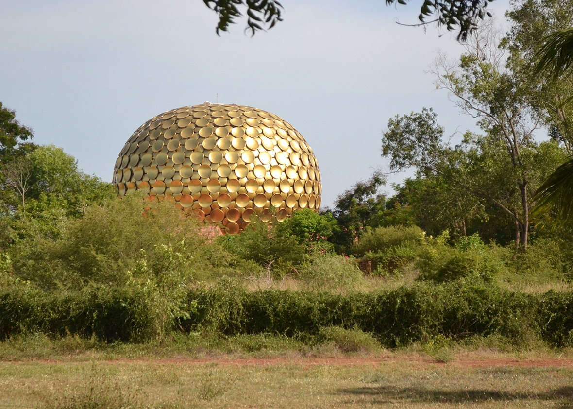 "The Matrimandir, otherwise known as ""the soul of Auroville,"" is a large meditation chamber built from gold-plated leaves. It sits at the center of the township."