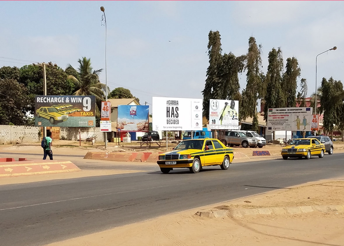 Billboards line the highway near Senegambia beach, a coastal area popular with foreign tourists.