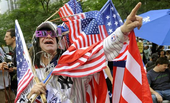 Demonstrators with 'Occupy Wall Street' protest at Zuccotti Park on October 10, 2011 in New York. What started as a ragtag camp in lower Manhattan to draw attention to corporate greed and corruption is now into its fourth week -- and commanding major national attention.