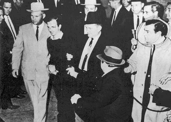 Lee Harvey Oswald being shot by Jack Ruby as Oswald is being moved by police, November 24, 1963