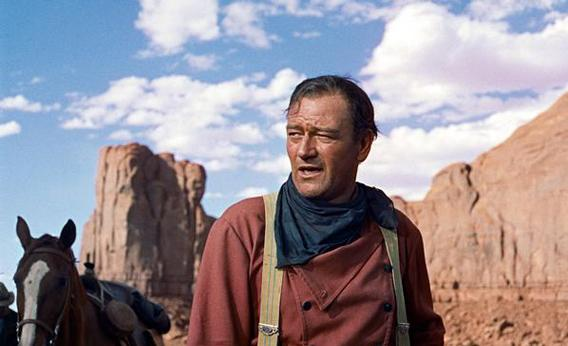 "John Wayne plays Ethan Edwards in the 1956 film ""The Searchers.""  Director John Ford and frequent leading man Wayne forged one of Hollywood's most enduring partnerships."