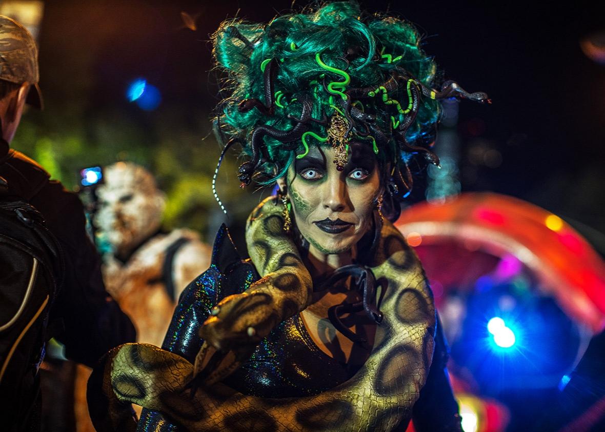 People dressed in Halloween costume take part in Halloween celebrations held within 43rd annual Village Halloween parade October 31, 2016 in New York.