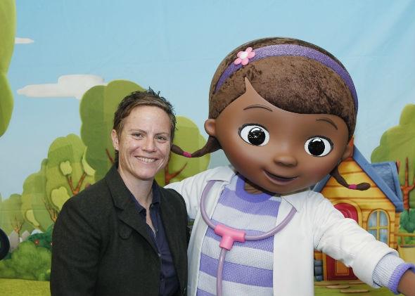 Chris Nee, creator and executive producer of Doc McStuffins, alongside the doctor herself.