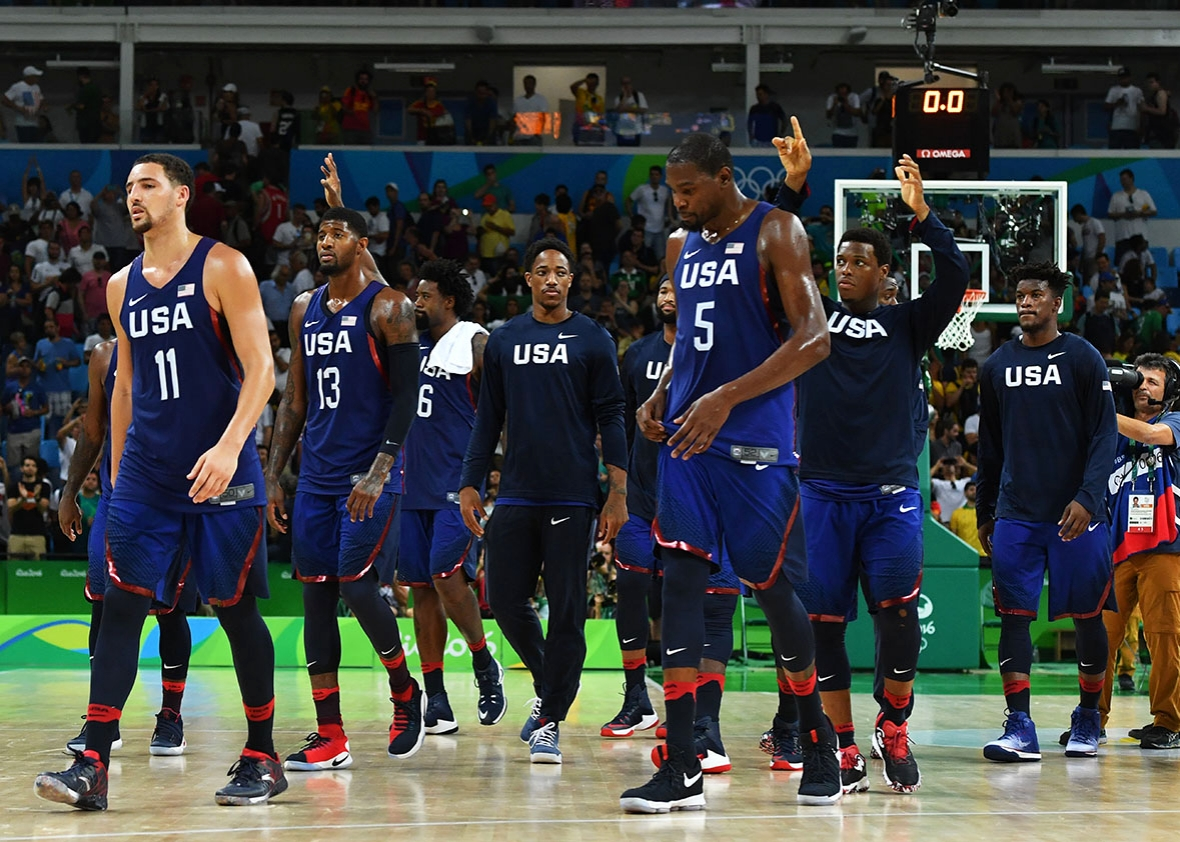 US team celebrate after winning a Men's semifinal basketball match between Spain and USA at the Carioca Arena 1 in Rio de Janeiro on August 19, 2016 during the Rio 2016 Olympic Games.
