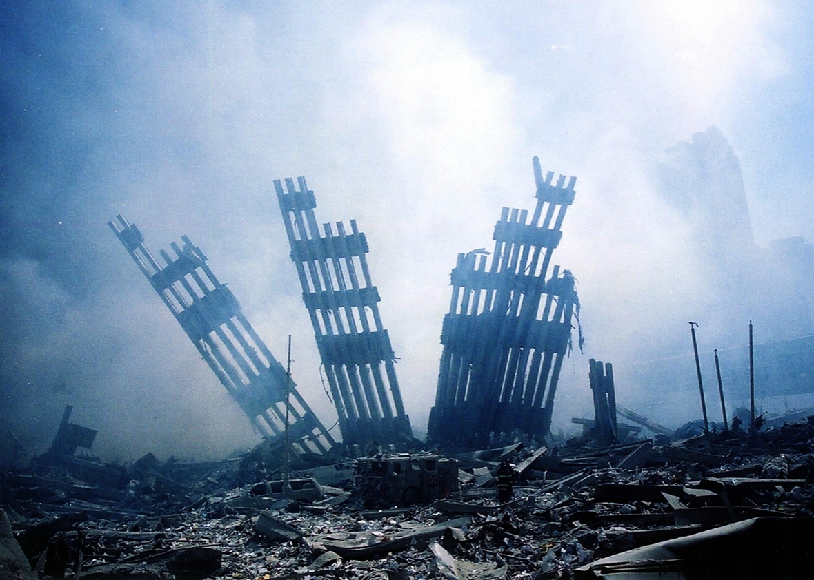 The rubble of the World Trade Center smoulders following a terrorist attack 11 September 2001 in New York.