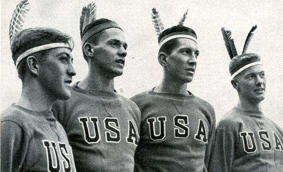This photo, published in a German cigarette company's review of the Olympics, shows Robert Moch, Gordon Adam, John White, and Joe Rantz in Indian headdresses.