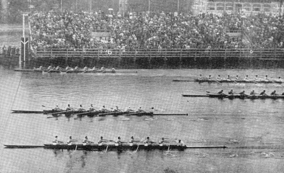The American crew (top) crosses the finish line first.