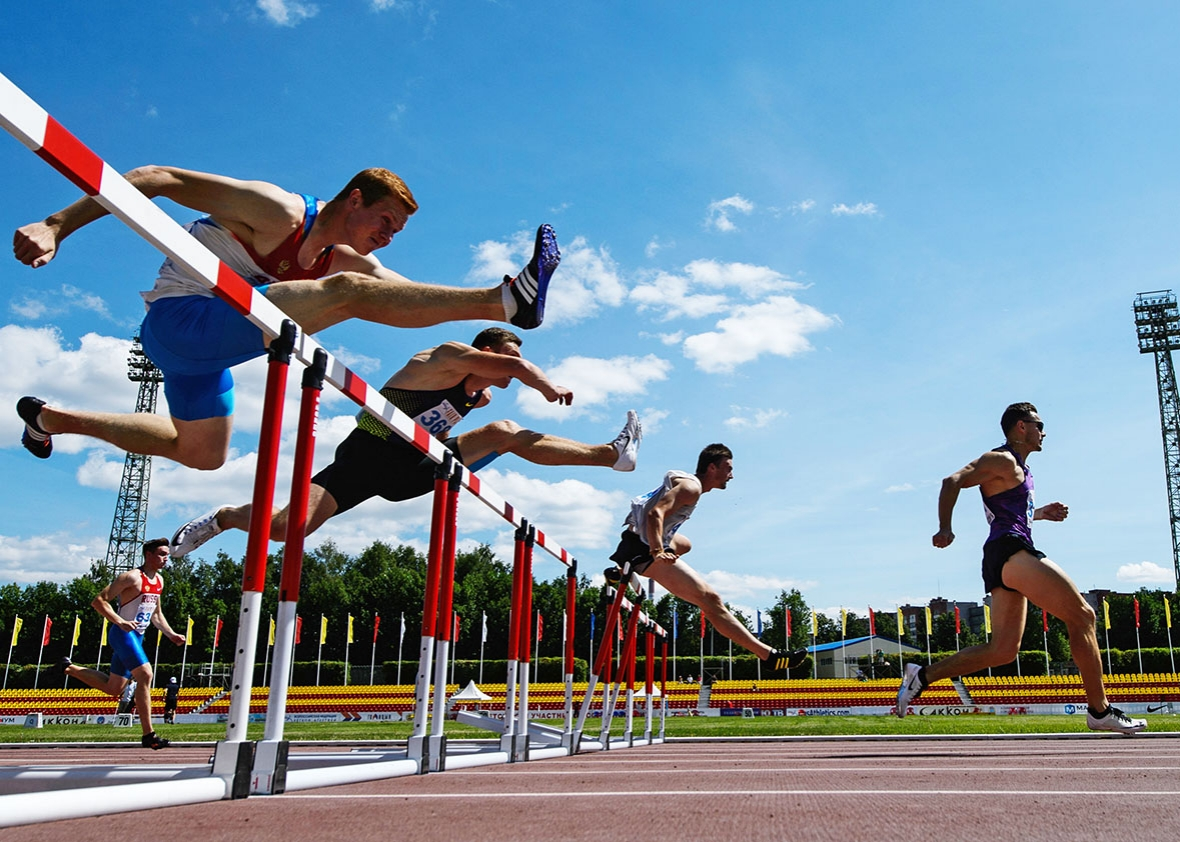 Athletes compete in the men's 110m hurdles event during the 2016 Russian national track and field championships.
