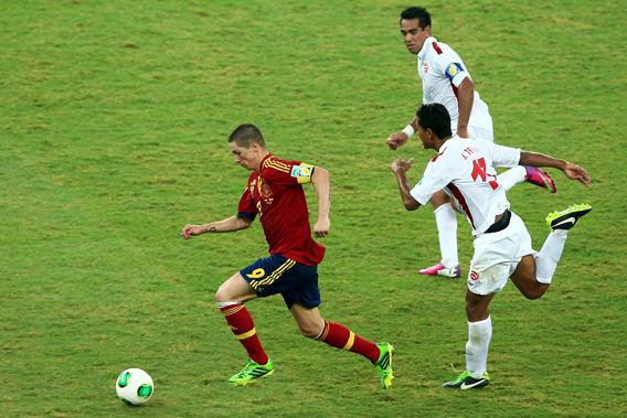Fernando Torres of Spain competes with Jonathan Tehau of Tahiti during the FIFA Confederations Cup Brazil 2013 Group B match between Spain and Tahiti at the Maracana Stadium on June 20, 2013 in Rio de Janeiro, Brazil.