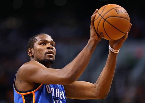 Kevin Durant #35 of the Oklahoma City Thunder shoots a free throw shot during the second half of the NBA game against the Phoenix Suns at US Airways Center on April 6, 2014 in Phoenix, Arizona.