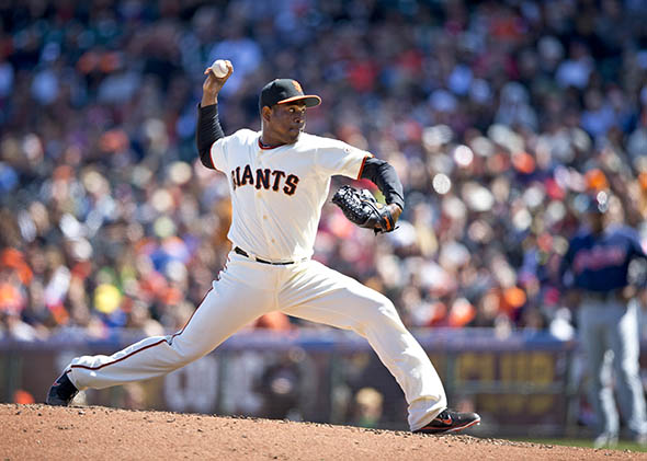 Santiago Casilla #46 of the San Francisco Giants pitches against the Cleveland Indians.