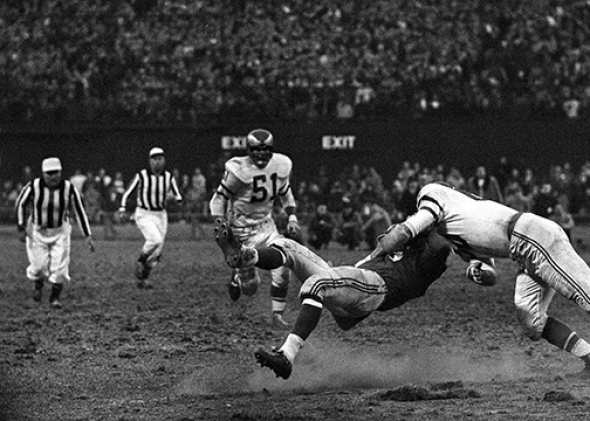 Linebacker Chuck Bednarik #60 (right), of the Philadelphia Eagle,Linebacker Chuck Bednarik #60 (right), of the Philadelphia Eagles, hits Frank Gifford #16 (center), of the New York Giants