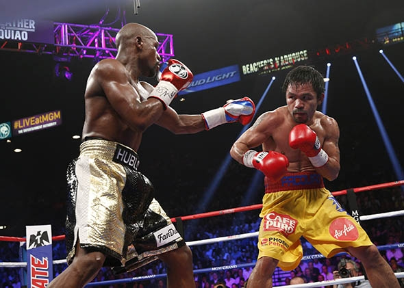 Floyd Mayweather Jr. exchange punches with Manny Pacquiao.