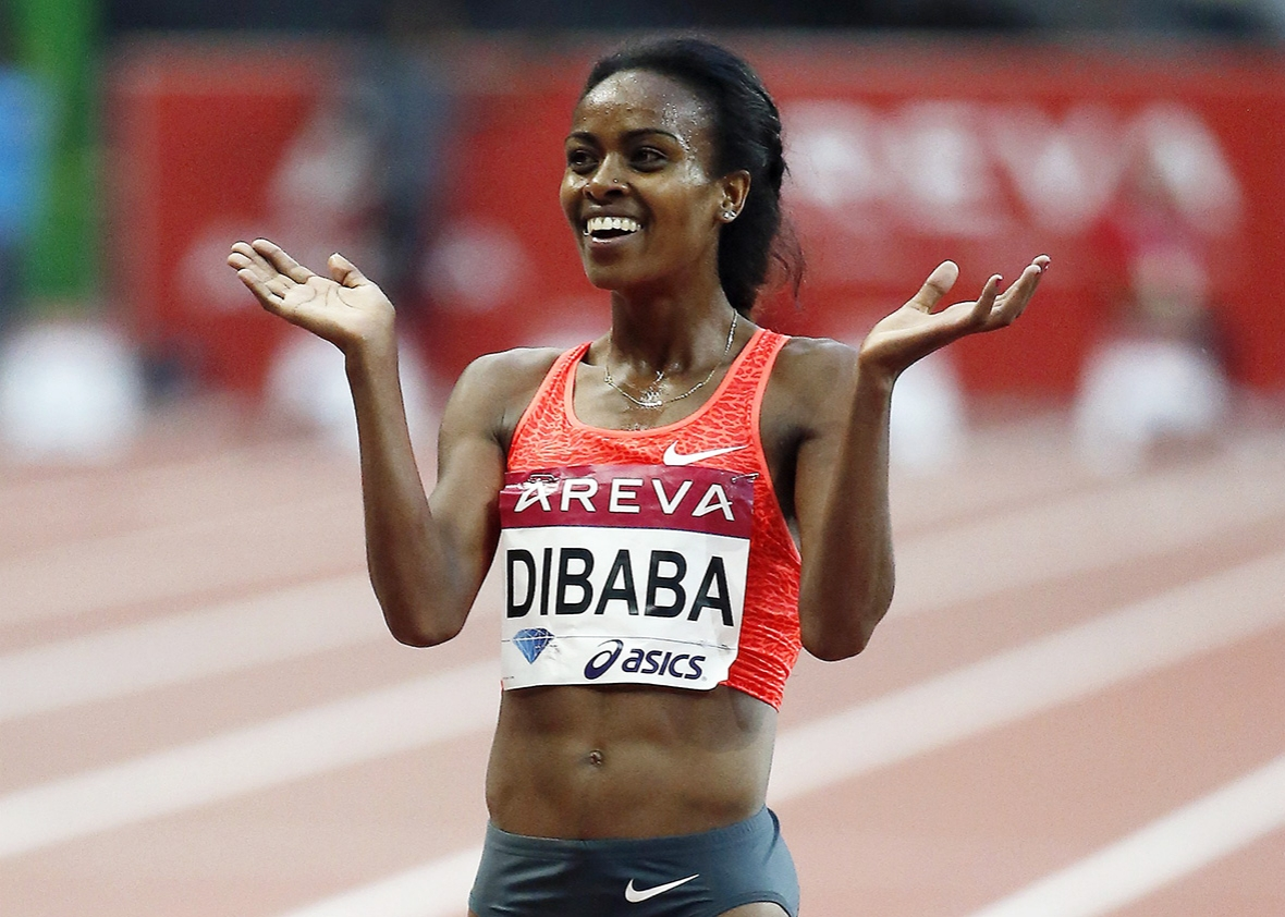 Ethiopia's Genzebe Dibaba celebrates after winning the women's 5000m during  the IAAF Diamond League athletics meeting