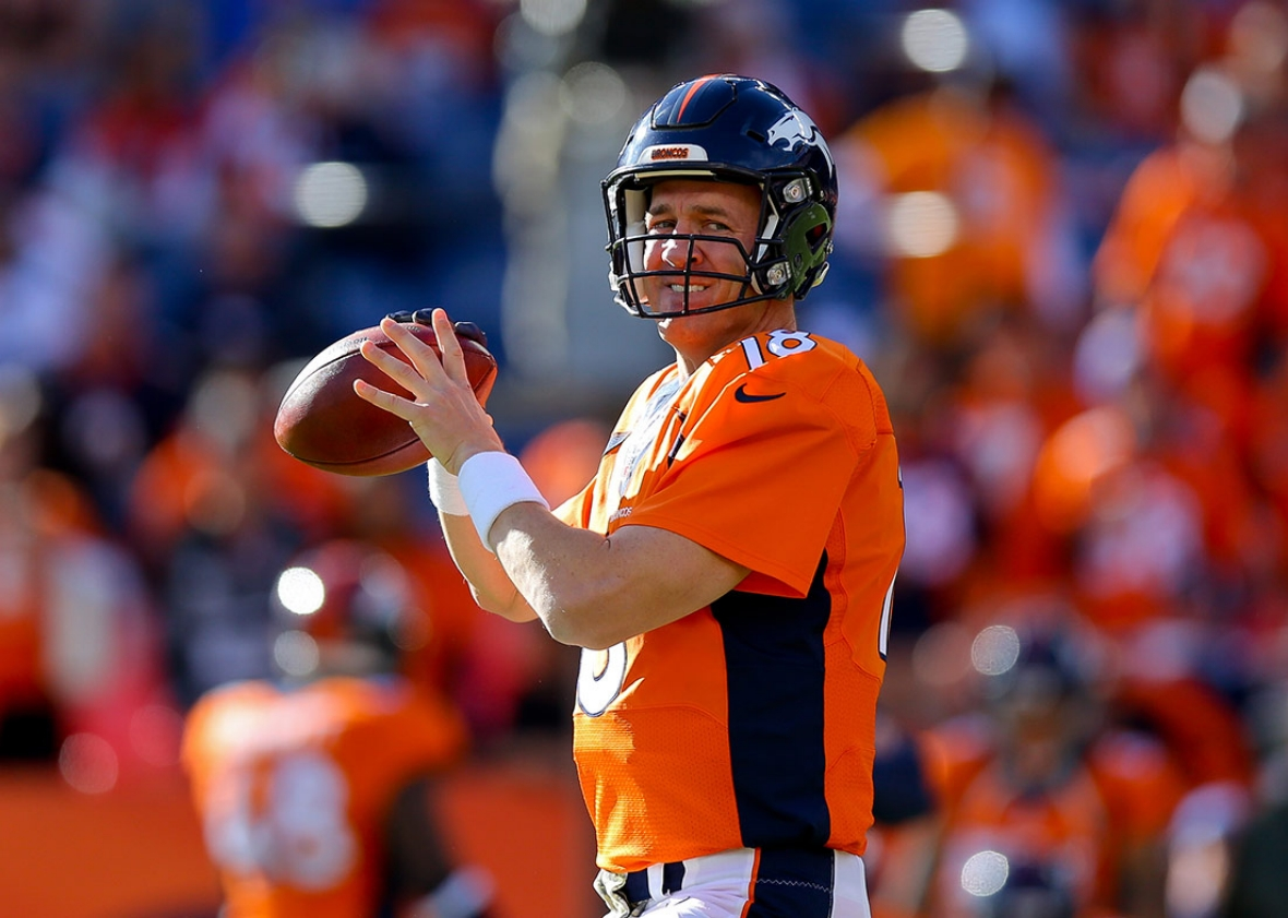 Peyton Manning of the Denver Broncos warms up before a game against the Kansas City Chiefs, Nov. 15, 2015, in Denver, Colorado.