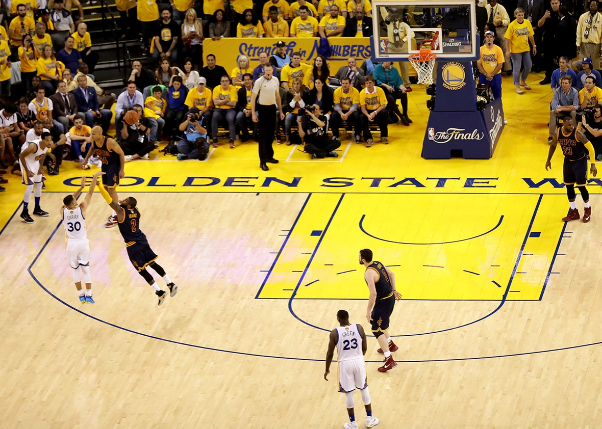 Stephen Curry #30 of the Golden State Warriors shoots a three pointer over Kyrie Irving #2 of the Cleveland Cavaliers in Game 1 of the 2016 NBA Finals at ORACLE Arena on June 2, 2016 in Oakland, California.