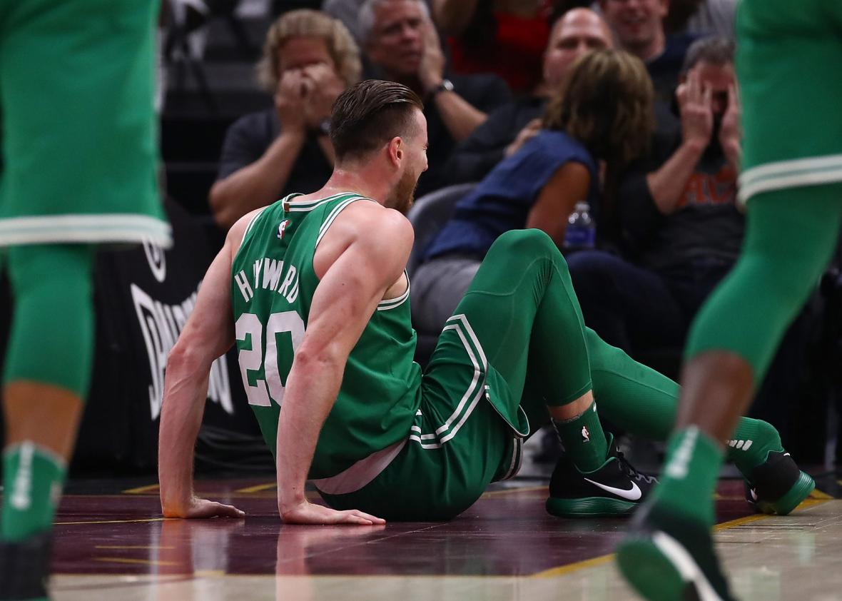 Gordon Hayward #20 of the Boston Celtics is sits on the floor after being injured.